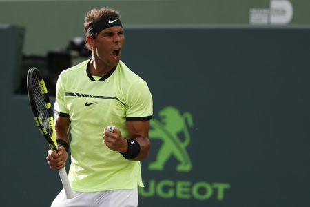 Mar 26, 2017; Miami, FL, USA; Rafael Nadal of Spain reacts after winning a game against Philip Kohlschreiber of Germany (not pictured) on day six of the 2017 Miami Open at Crandon Park Tennis Center. Mandatory Credit: Geoff Burke-USA TODAY Sports