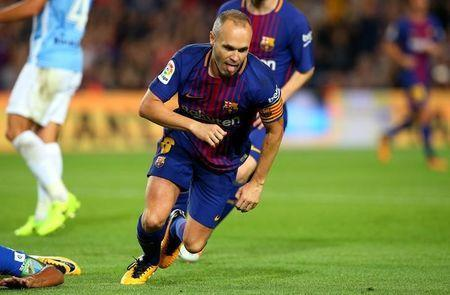 Soccer Football - La Liga Santander - FC Barcelona vs Malaga CF - Camp Nou, Barcelona, Spain - October 21, 2017 Barcelona's Andres Iniesta celebrates scoring their second goal REUTERS/Albert Gea