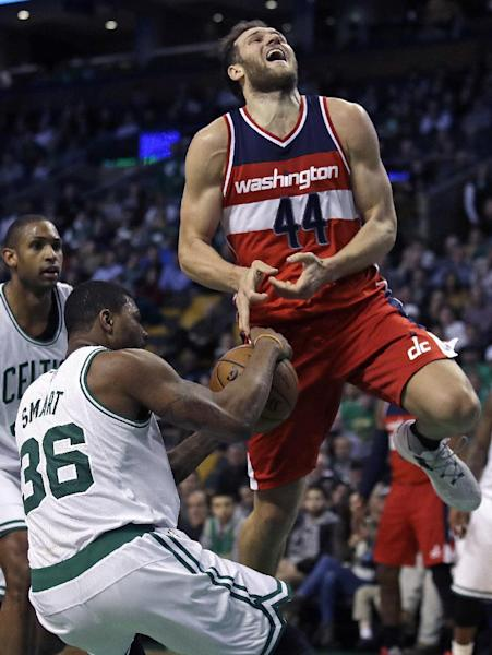 Washington Wizards guard Bojan Bogdanovic (44) loses the ball as Boston Celtics guard Marcus Smart (36) rips it from his grip on a drive to the basket during the second half of an NBA basketball game in Boston, Monday, March 20, 2017. The Celtics defeated the Wizards 110-102. (AP Photo/Charles Krupa)