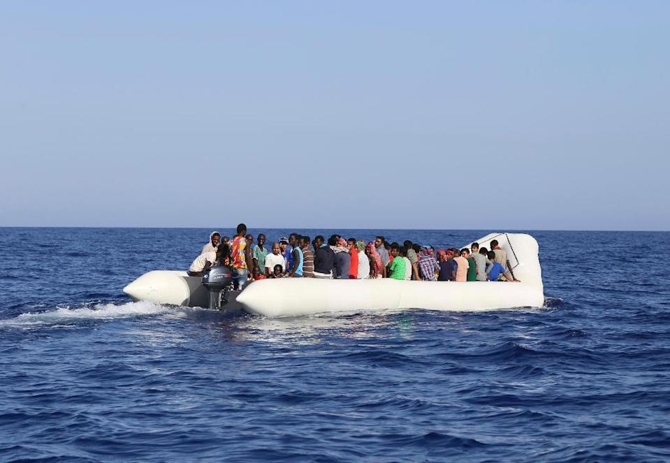 Migrants are rescued by Malta-based NGO Migrant Offshore Aid Station (MOAS) off Libya (AFP Photo/)