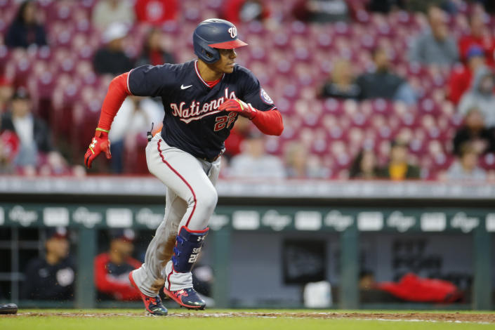 Washington Nationals' Juan Soto runs to first after hitting a single during the second inning of a baseball game Thursday, Sept. 23, 2021, in Cincinnati. (AP Photo/Jay LaPrete)
