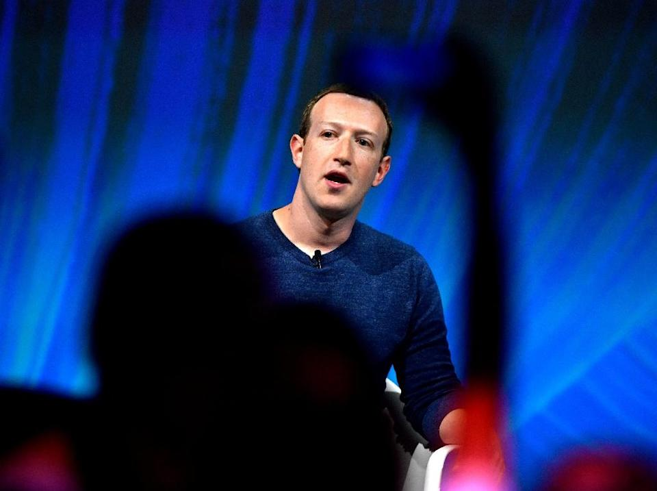 Facebook's CEO Mark Zuckerberg has called for global regulations on internet platforms but critics say the leading social network is shirking its responsibility to weed out violent and abusive content (AFP Photo/GERARD JULIEN)