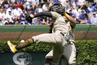 San Diego Padres' Ha-Seong Kim, foreground, and Tommy Pham collide going after a fly ball hit by Chicago Cubs' P.J. Higgins in the fourth inning of a baseball game Wednesday, June 2, 2021, in Chicago. (AP Photo/Charles Rex Arbogast)