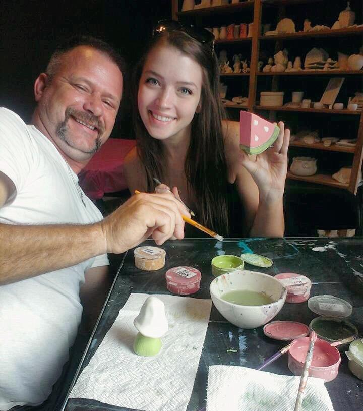 Rylee Black, right, shares a moment at the paint table with her father
