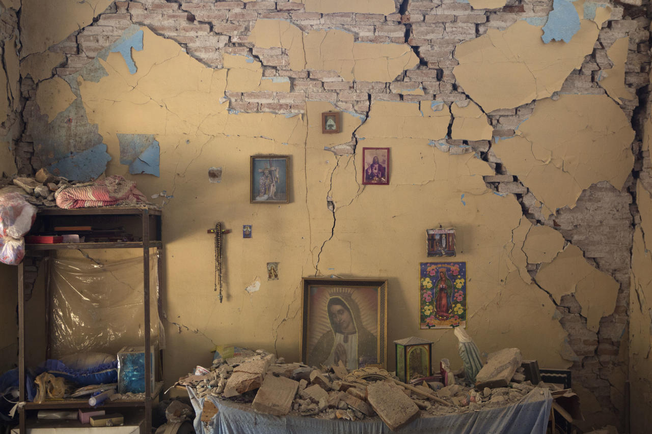 <p>An altar to the Virgin of Guadalupe is covered with fallen debris inside the earth-damaged home where Larissa Garcia, 24, lived with her family in Juchitan, Oaxaca state, Mexico, Saturday, Sept. 9, 2017. The family was caught under rubble when the house partially collapsed, leaving Garcia with a broken arm and her father with a head injury. Her mother, who had to be pulled out from underneath a foot-thick section of wall which collapsed on her back, remains in a wheelchair and unable to walk. (AP Photo/Rebecca Blackwell) </p>