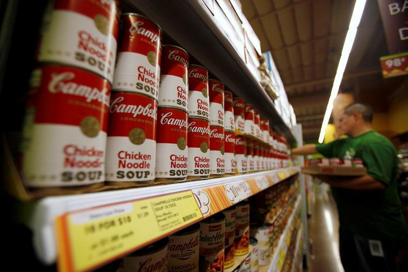 FILE PHOTO: A worker restocks Campbell's soup cans inside a Fresh & Easy store in Burbank
