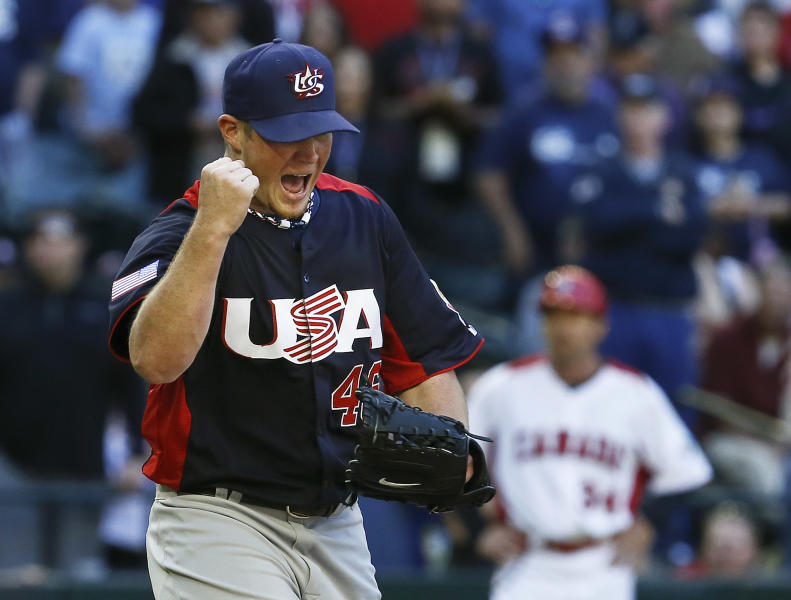 United States' Craig Kimbrel shouts and pumps his fist as Canada coach Tim Leiper puts his hands on his hips after the final out is recorded in the ninth inning for a United States win during a World Baseball Classic baseball game on Sunday, March 10, 2013, in Phoenix. The United States defeated Canada 9-4. (AP Photo/Ross D. Franklin)