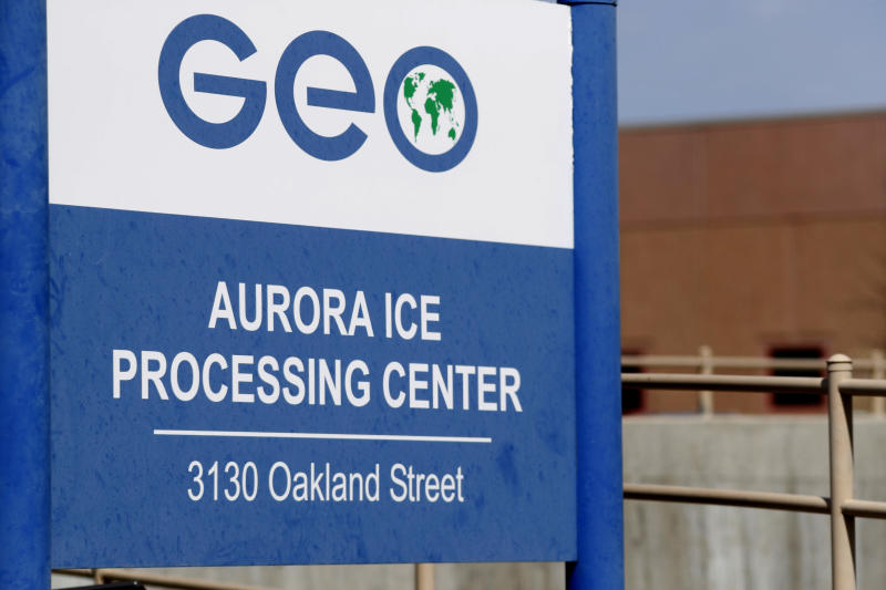 FILE - This April 15, 2017, file photo, shows the entrance to the GEO Group's immigrant detention facility in Aurora, Colo. The Homeland Security Department's internal watchdog says rotting food, moldy and dilapidated bathrooms and agency practices at immigration detention facilities may violate detainees' rights. At the facility in Aurora detainees were not allowed visits from friends or families, even though there was room for them to do so. Managers said they were concerned about drugs or weapons being smuggled, but acknowledged that visits should be considered. (AP Photo/David Zalubowski, File)