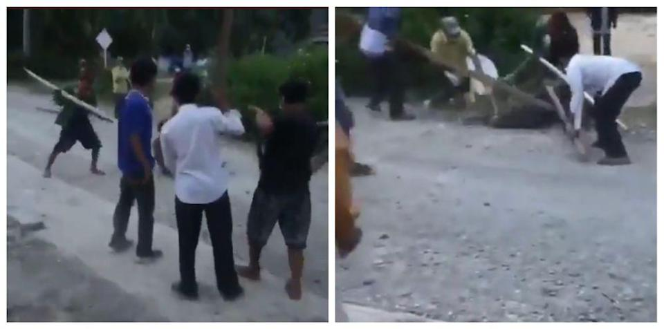 The residents from a town in North Sumatra's Toba regency used bamboo sticks to hold down the infected man to maintain physical distancing. —  Twitter screengrabs