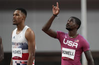 Trayvon Bromell, of the United States, gestures prior to his heat of the men's 100-meters at the 2020 Summer Olympics, Saturday, July 31, 2021, in Tokyo. (AP Photo/David J. Phillip)