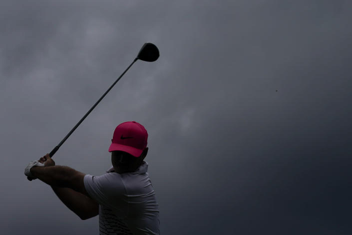 Brooks Koepka tees off on the 18th hole during the second round of the Masters golf tournament on Friday, April 9, 2021, in Augusta, Ga. (AP Photo/Charlie Riedel)
