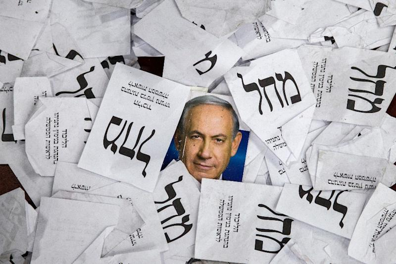 Copies of ballot papers and campaign posters for Israel's Prime Minister Benjamin Netanyahu's Likud Party lie on the ground in the aftermath of the country's parliamentary elections, early on March 18, 2015 in Tel Aviv (AFP Photo/Jack Guez)