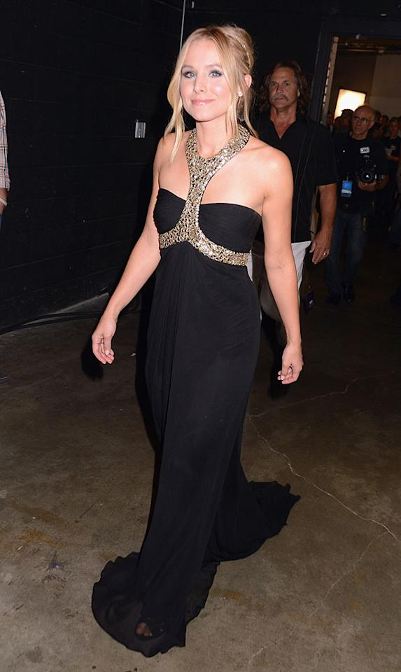 """Kristen Bell wore a multitude of cute dresses while co-hosting this year's <a target=""""_blank"""" href=""""http://omg.yahoo.com/photos/2012-cmt-music-awards-1339022687-slideshow/"""">CMT Awards</a> with Toby Keith, but the gown we were particularly fond of was this effortlessly beautiful Monique Lhuillier halter, which featured glam gold detailing and chiffon draping. (6/6/2012)"""