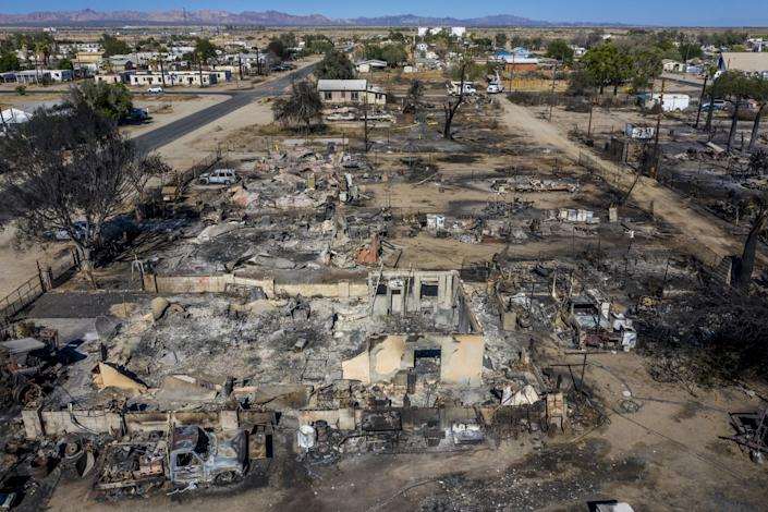 "Blocks of homes in Niland, Calif., lay in ashes on Monday, the day after high winds stoked a wildfire. <span class=""copyright"">(Robert Gauthier / Los Angeles Times)</span>"