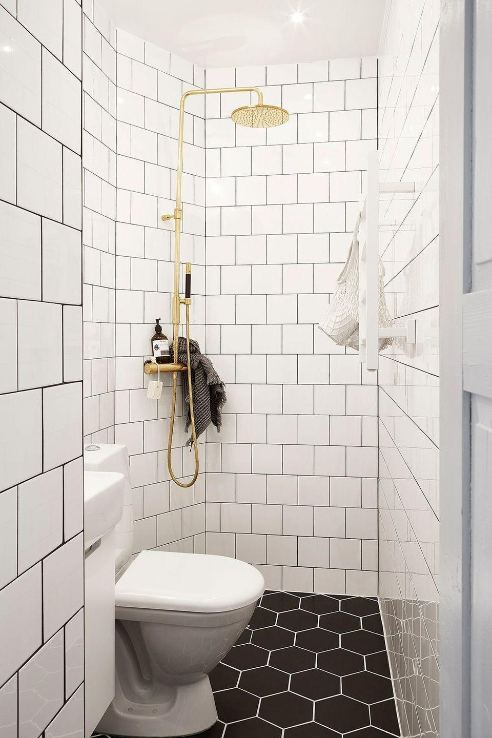<p>The central drain in this bathroom is the ultimate space-savvy hack. Essentially, the bathroom and shower floor are one. The lack of a door and closed off flooring area will ensure the space feels as open as possible.</p>