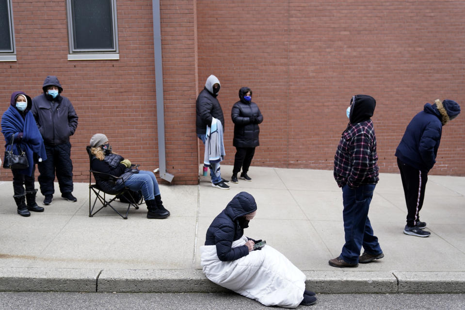 People wait in line for the COVID-19 vaccine in Paterson, N.J.,  on Jan. 21, 2021. The first people arrived around 2:30 a.m. for the chance to be vaccinated at one of the few sites that does not require an appointment. (Seth Wenig/AP)