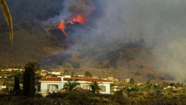 """Residents on the island have expressed shock at the sudden eruption. """"When the volcano erupted today, I was scared. For journalists it is something spectacular, for us it is a tragedy. I think the lava has reached some relatives' houses,"""" Isabel Fuentes was quoted as telling broadcaster TVE. AP"""