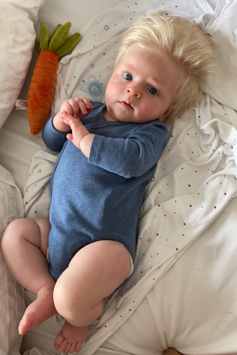 David was born with floppy blond hair has been called the spitting image of Boris Johnson. (Caters)