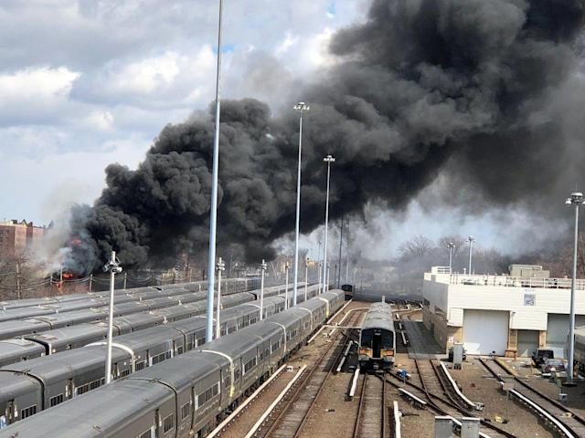 A fire breaks at a New York recycling plant next to the tracks of the Long Island Rail Road in New York City, New York, US., March 16, 2018 in this picture obtained from social media. MTA LONG ISLAND RAIL ROAD/via REUTERS THIS IMAGE HAS BEEN SUPPLIED BY A THIRD PARTY. MANDATORY CREDIT. NO RESALES. NO ARCHIVES TPX IMAGES OF THE DAY