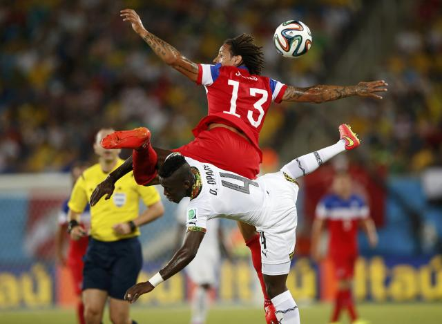 Jermaine Jones (13) of the U.S. jumps for the ball against Ghana's Daniel Opare during their 2014 World Cup Group G soccer match at the Dunas arena in Natal June 16, 2014. REUTERS/Toru Hanai (BRAZIL - Tags: SOCCER SPORT WORLD CUP TPX IMAGES OF THE DAY)