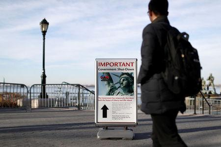 A sign announcing the closure of the Statue of Liberty, due to the U.S. government shutdown, sits near the ferry dock to the Statue of Liberty at Battery Park in Manhattan, New York, U.S., January 20, 2018. REUTERS/Andrew Kelly