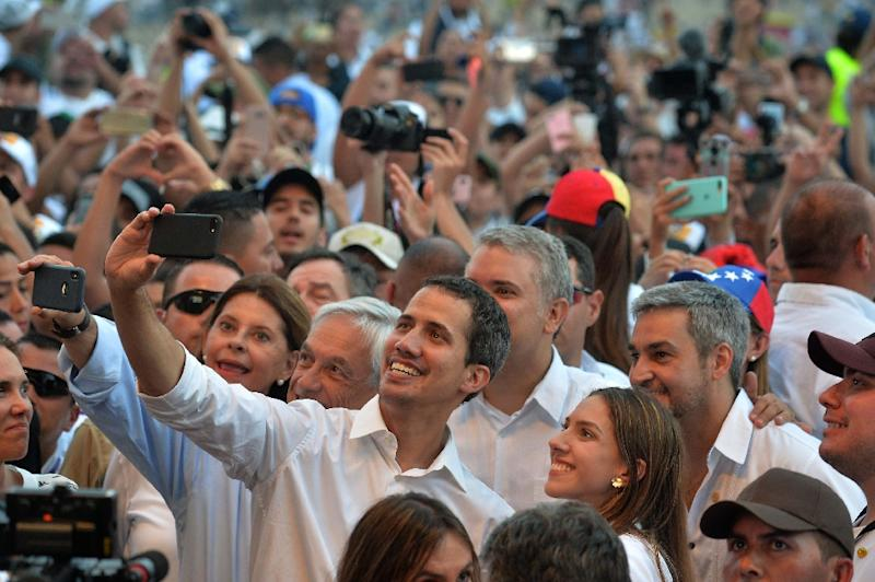 Venezuela's opposition leader Juan Guaido takes a selfie with his wife Fabiana Rosales and Chilean President Sebastian Pinera, Colombian President Ivan Duque, and Paraguayan President Mario Abdo Benitez at the