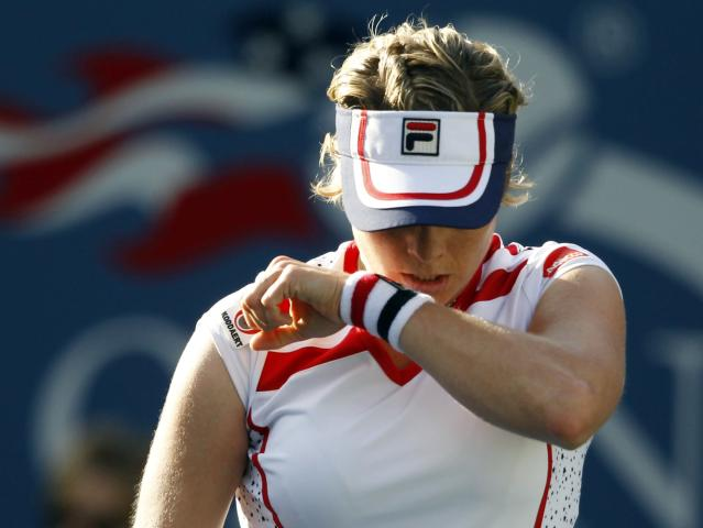 Kim Clijsters of Belgium wipes her face during her match against Laura Robson of Great Britain in the second round of play at the 2012 US Open tennis tournament, Wednesday, Aug. 29, 2012, in New York. (AP Photo/Mel C. Evans)