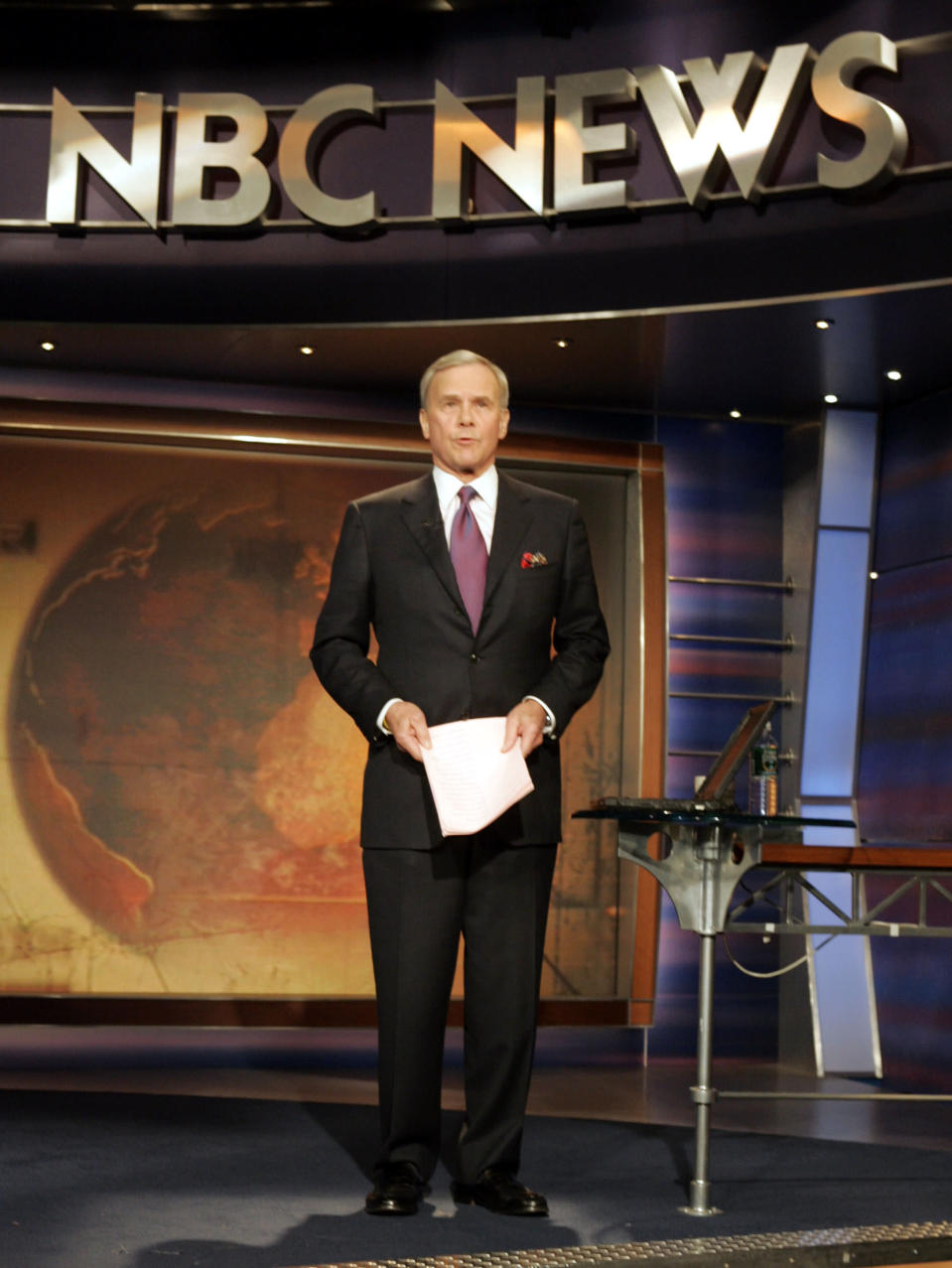 "FILE - ""NBC Nightly News"" anchor Tom Brokaw delivers his final broadcast, in New York Wednesday Dec. 1, 2004. Brokaw says he is retiring from NBC News after working at the network for 55 years. The author of ""The Greatest Generation"" is now 80 years old and his television appearances have been limited in recent years as he fought cancer. He says he will continue writing books and articles. (AP Photo/Richard Drew, File)"