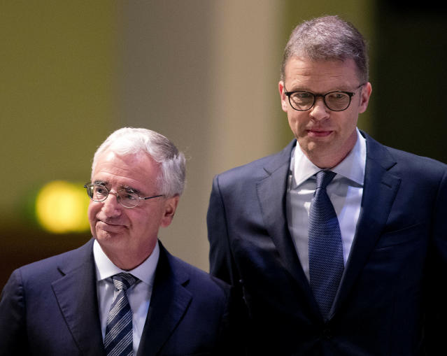 CEO of Deutsche Bank Christian Sewing, right, and head pf supervisory board Paul Achleitner are on their way to the annual shareholders meeting in Frankfurt, Germany, Thursday, May 23, 2019. (AP Photo/Michael Probst)