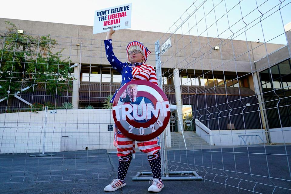 Trump supporter Tara Immen of Happy Valley, Ariz., protests at the Maricopa County Elections Department in Phoenix on Nov. 18, 2020.