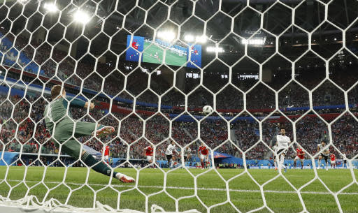 Egypt's Mohamed Salah scores his side's opening goal on a penalty during the group A match between Russia and Egypt at the 2018 soccer World Cup in the St. Petersburg stadium in St. Petersburg, Russia, Tuesday, June 19, 2018. (AP Photo/Martin Meissner)