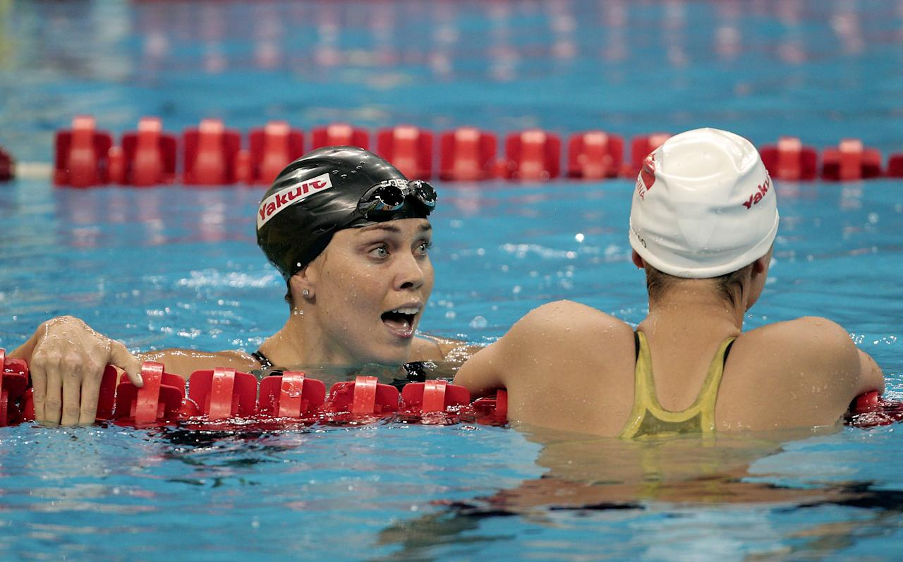 SHANGHAI, CHINA - JULY 26:  Natalie Coughlin (L) of the United States reacts after winning the bronze medal in the Women's 100m Backstroke Final during Day Eleven of the 14th FINA World Championships at the Oriental Sports Center on July 26, 2011 in Shanghai, China.  (Photo by Adam Pretty/Getty Images)
