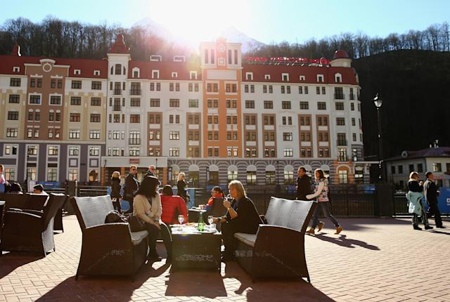 SOCHI, RUSSIA - FEBRUARY 13: Visitors dine and enjoy the sun at Rosa Khutor Mountain Cluster village on day six of the Sochi 2014 Winter Olymipcs on February 13, 2014 in Sochi, Russia. (Photo by Al Bello/Getty Images)