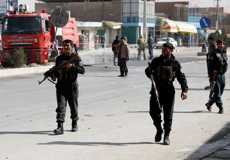 Afghan policemen keep watch at the site of a suicide attack in Kabul Afghanistan