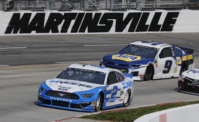 Brad Keselowski (2) leads Chase Elliott (9) as they drive into Turn 4 during a NASCAR Cup Series auto race at the Martinsville Speedway in Martinsville, Va., Sunday, March 24, 2019. (AP Photo/Steve Helber)