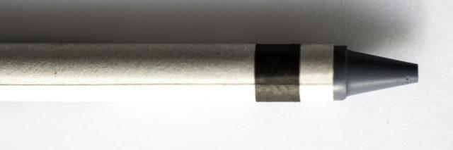 Grey crayon on a white background.