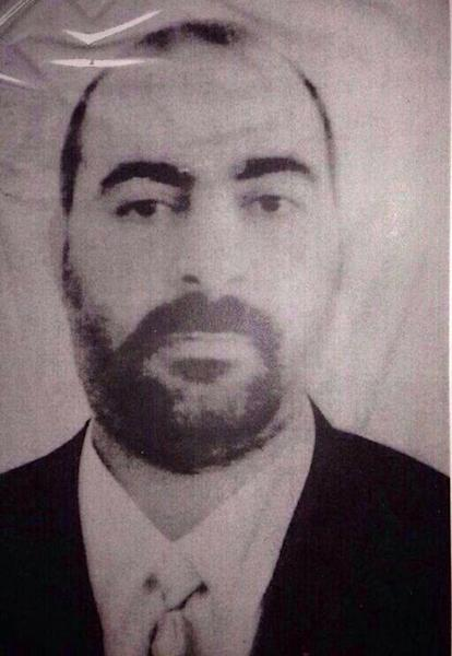 FILE - Undated file picture released on Wednesday Jan. 29, 2014, by the official website of Iraq's Interior Ministry claiming to show Abu Bakr al-Baghdadi, the head of the so-called Islamic State of Iraq and the Levant. Al-Qaida's central leadership broke with one of its most powerful branch commanders, who in defiance of its orders spread his operations from Iraq to join the fighting in Syria and fueled bitter infighting among Islamic militant factions in Syria's civil war. The announcement sharpens a dispute raging the past year between al-Qaida's central leadership and the faction known as the Islamic State of Iraq and the Levant, which was created last year by, Al-Baghdadi. He formed the group to expand his operations into neighboring Syria in defiance of direct orders by Ayman al-Zawahri not to do so and to stick to operations within Iraq. (AP Photo/Iraqi Interior Ministry, File)
