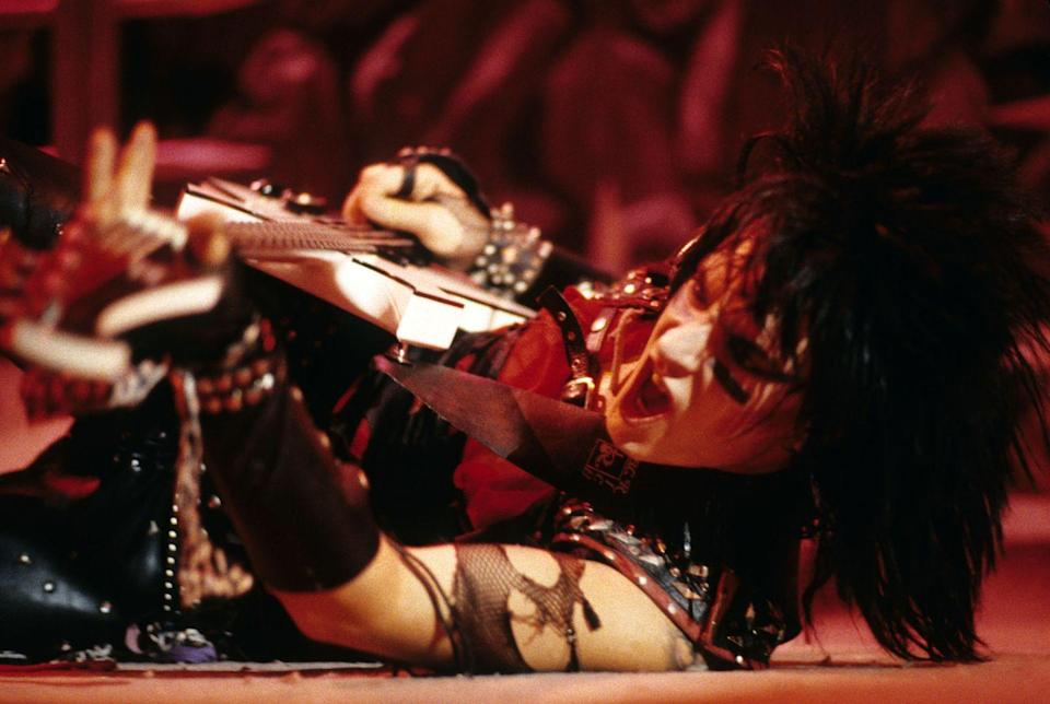 <p>Prior to forming Mötley Crüe, Sixx was a member of Sister. After being fired from the band, he founded London with his Sister bandmate, Lizzie Grey. Third time's a charm, because his next venture was Mötley Crüe. Here he is performing at a concert in New York City in 1984.</p>