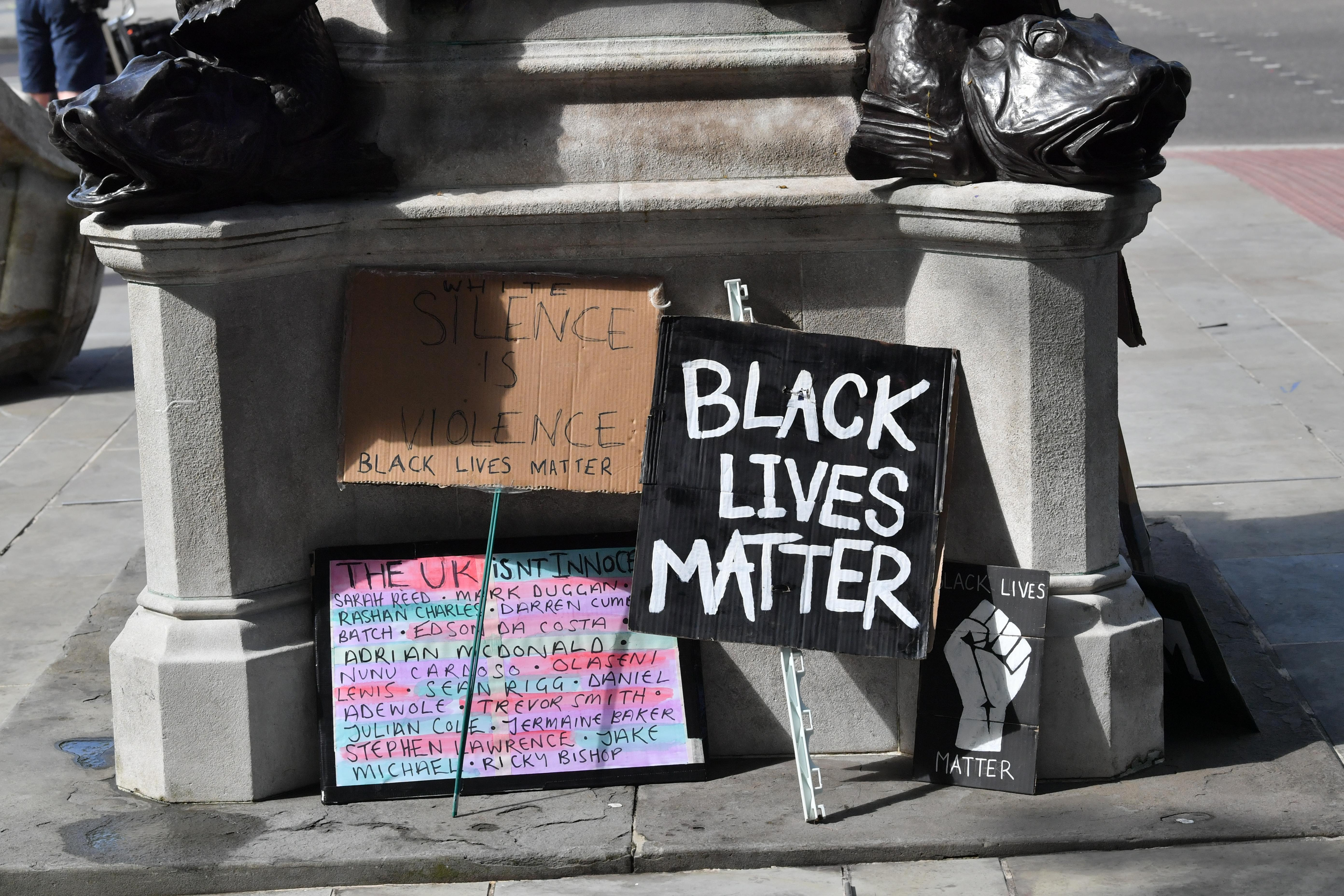 Signs by the empty plinth where the statue of Edward Colston in Bristol once stood after it was taken down during a Black Lives Matter protest on Sunday. The protests were sparked by the death of George Floyd, who was killed on May 25 while in police custody in the US city of Minneapolis.
