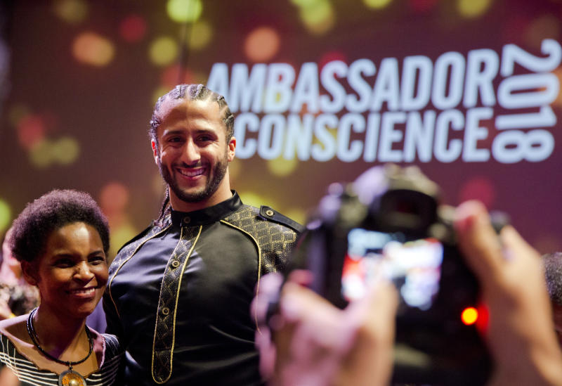 Former NFL quarterback Colin Kaepernick, posing at the Amnesty International Ambassador of Conscience Award in April, is facing a strong legal move from the NFL. (AP)