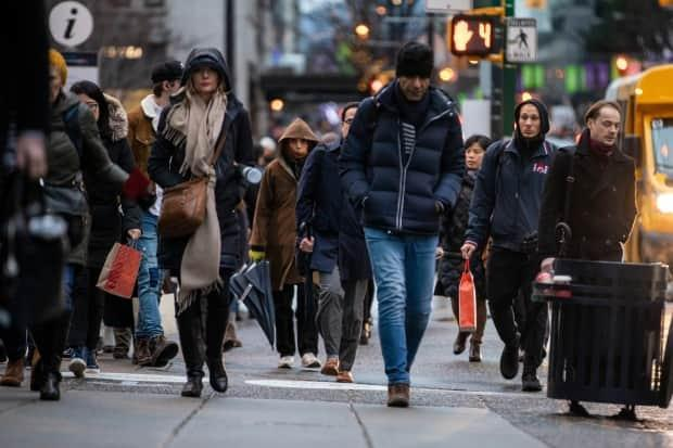 Pedestrians in Vancouver on Dec. 17, 2019. Metro Vancouver planners anticipate the region will grow by more than one million people by 2050.  (Ben Nelms/CBC - image credit)