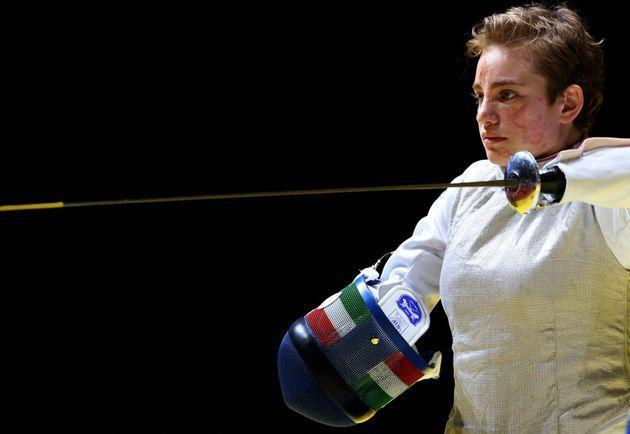 Italy's Beatrice Vio puts on her mask to compete with Russia's Ludmila Vasileva in the wheelchair fencing women's foil individual category B semi-final bout during the Tokyo 2020 Paralympic Games at Makuhari Messe Hall in Chiba on August 28, 2021. (Photo by Behrouz MEHRI / AFP) (Photo by BEHROUZ MEHRI/AFP via Getty Images) (Photo: BEHROUZ MEHRI via Getty Images)