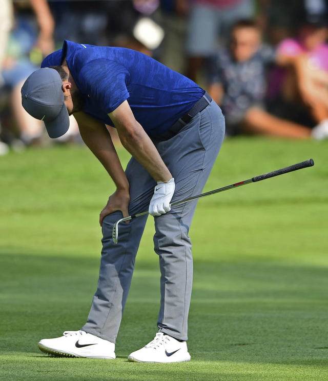 Kyle Stanley reacts after his approach shot on the 18th hole during the final round of the Bridgestone Invitational golf tournament at Firestone Country Club, Sunday, Aug. 5, 2018, in Akron, Ohio. (AP Photo/David Dermer)
