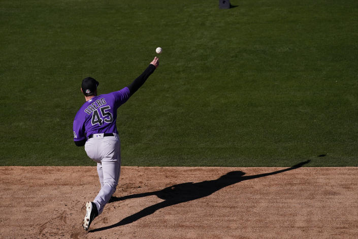 Colorado Rockies pitcher Scott Oberg throws a pitch during the team's spring training baseball workout in Scottsdale, Ariz., Wednesday, Feb. 24, 2021. (AP Photo/Jae C. Hong)