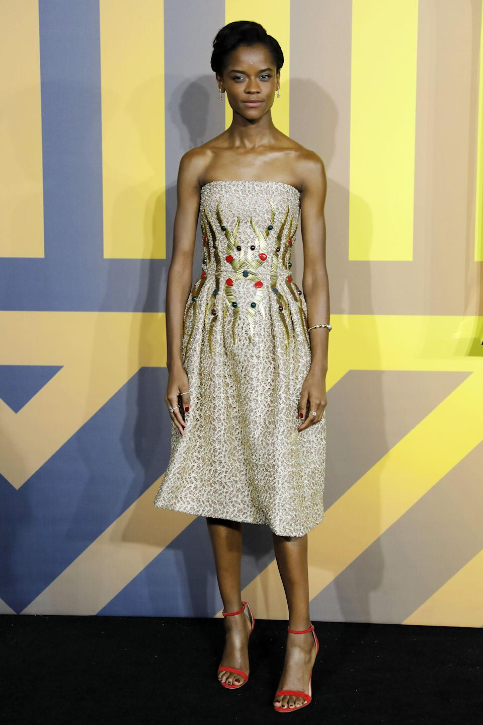 <p>The 24-year-old Guyanese-born British actress wore a strapless Rami Al Ali dress. <em>[Photo: Getty] </em> </p>