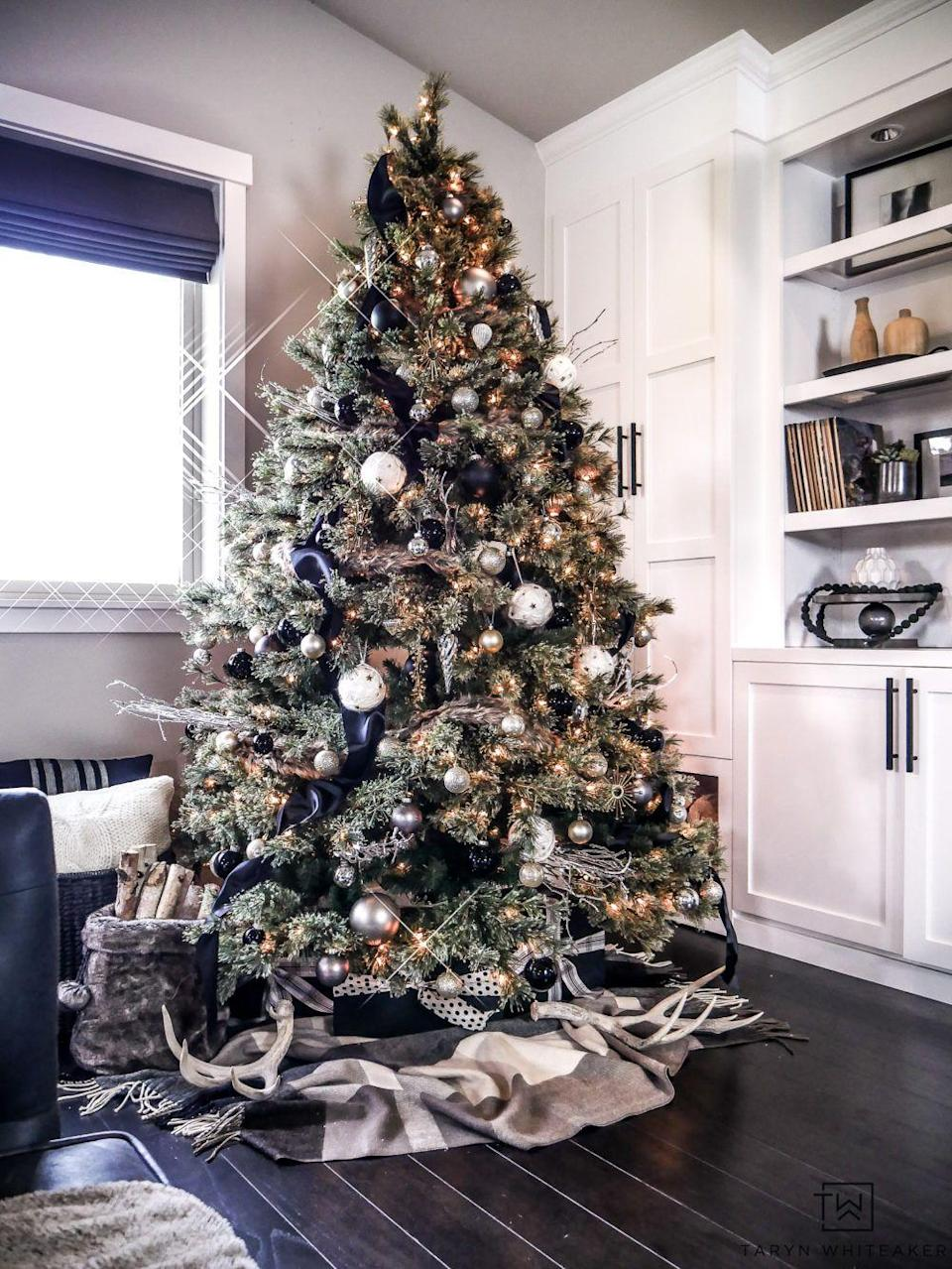 """<p>A black and gold tree is the picture of opulence, especially when you mix black matte and black glossy balls and incorporate plenty of sparkly pieces. </p><p><strong><em>Get the tutorial at <a href=""""https://tarynwhiteaker.com/rustic-modern-christmas-tree-2/"""" rel=""""nofollow noopener"""" target=""""_blank"""" data-ylk=""""slk:Taryn Whitaker Designs"""" class=""""link rapid-noclick-resp"""">Taryn Whitaker Designs</a>. </em></strong></p><p><a class=""""link rapid-noclick-resp"""" href=""""https://www.amazon.com/Humphreys-Craft-Non-Toxic-Decorative-Colorful/dp/B07X8FFRGM?tag=syn-yahoo-20&ascsubtag=%5Bartid%7C10070.g.2025%5Bsrc%7Cyahoo-us"""" rel=""""nofollow noopener"""" target=""""_blank"""" data-ylk=""""slk:SHOP BLACK RIBBON"""">SHOP BLACK RIBBON </a></p>"""