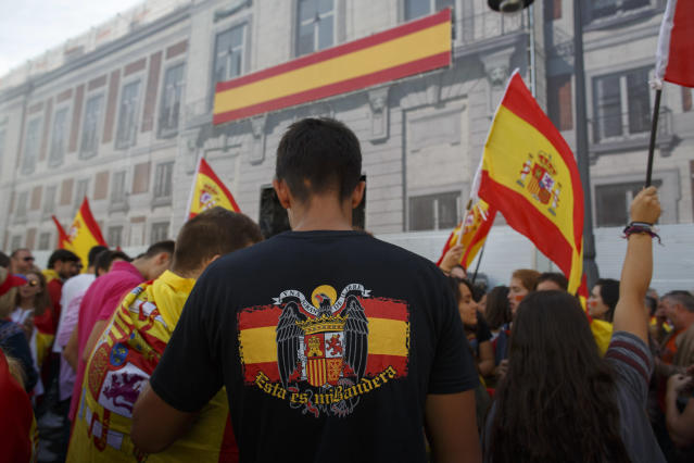 <p>An anti-separatist demonstrator wears a t-shirt with the image of the pre-constitutional Spanish flag during a protest in support of Spain's unity as Catalonian votes in referendum on Oct. 1, 2017 in Madrid, Spain. (Photo: Pablo Blazquez Dominguez/Getty Images) </p>