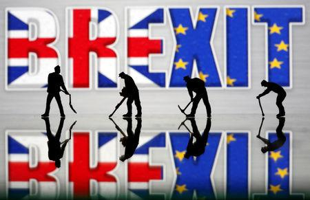 Small toy figures are seen in front of a Brexit logo in this illustration picture, March 30, 2019. REUTERS/Dado Ruvic/Illustration