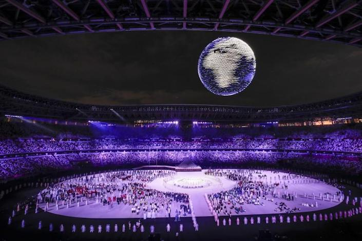 Tokyo, Japan, Friday, July 23, 2021 - Lighted drones take shape of a spinning earth at the Tokyo 2020 Olympics Opening Ceremony at Olympic Stadium. (Robert Gauthier/Los Angeles Times)