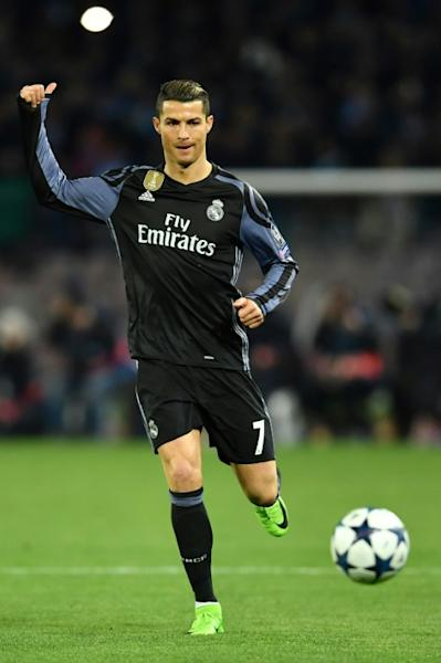 Real Madrid's Cristiano Ronaldo eyes the ball during their UEFA Champions League match against Napoli, at the San Paolo stadium in Naples, on March 7, 2017
